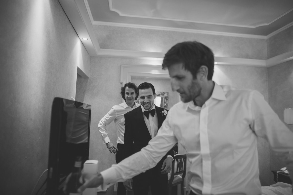 Romantic Lake Como wedding. Groom and his groomsmen. Grand Hotel Tremezzo destination wedding photographer