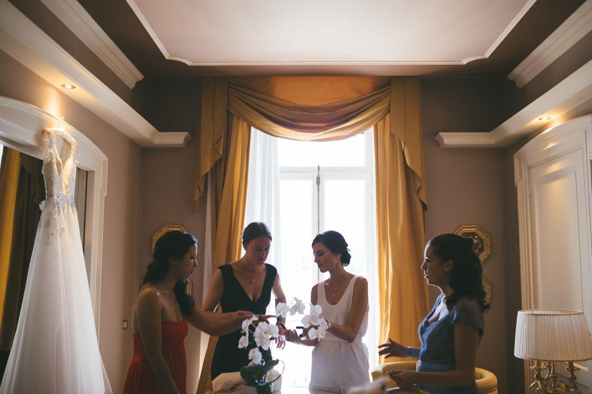 Romantic Lake Como wedding. Bride and her bridesmaids. Grand Hotel Tremezzo destination wedding photographer