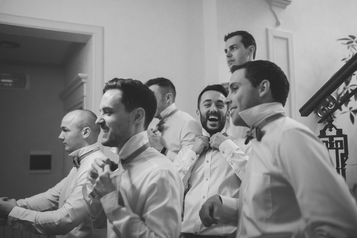 Vincigliata Castle Wedding photographer. Groom and his groomsmen. Destination wedding in Tuscany Florence.