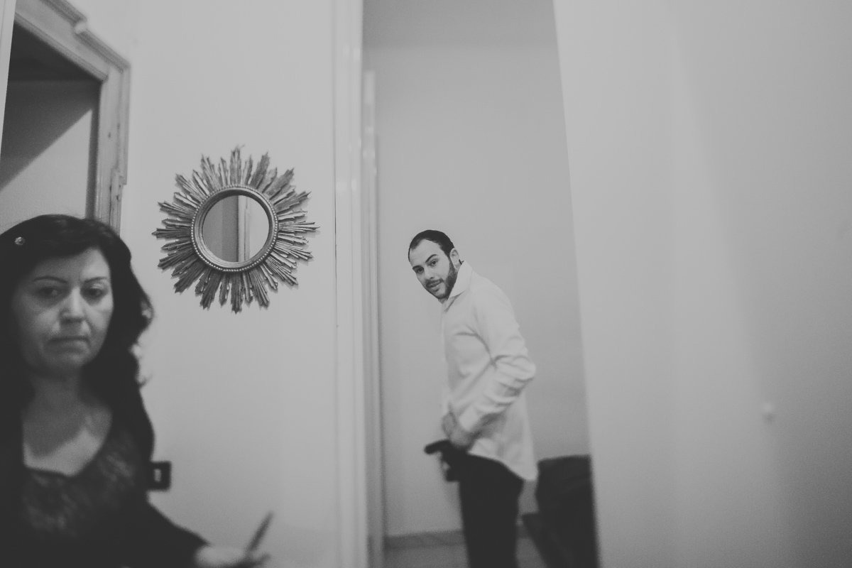 Destination Wedding Photographer in Milan, Italy. Awesome wedding session in Palazzo Reale venue.. Groom is getting ready