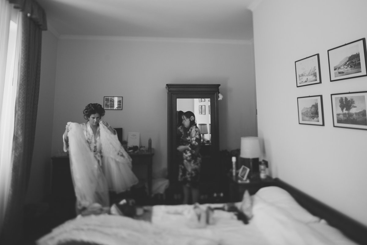 Lake como wedding photographer. Wearing bridal dress