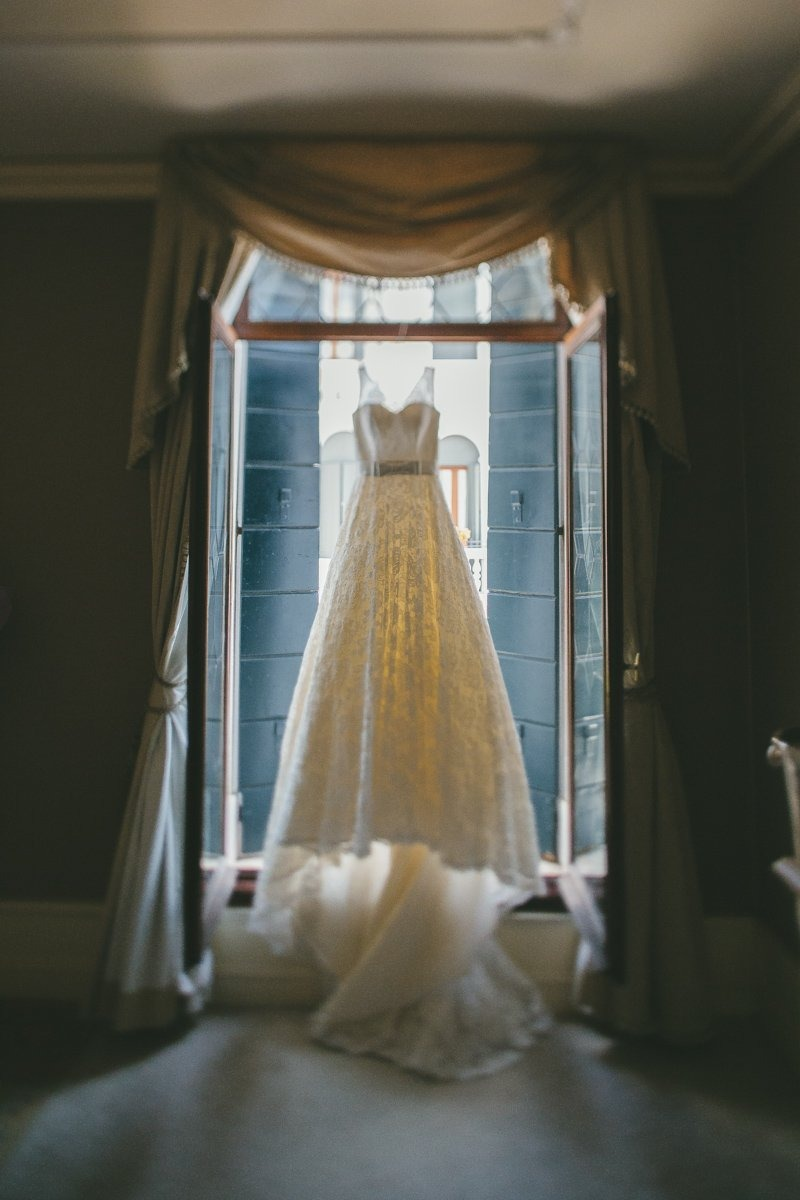 Venice Elopement photographer. Exchange vows in Venice canal. Bride dress