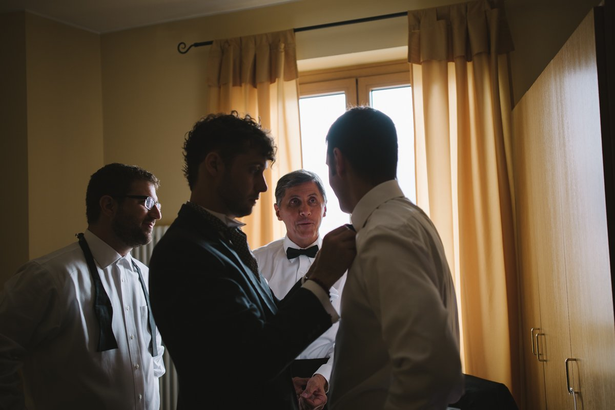 Lake Como Wedding. Italiahn wedding photographer. Groom and his groomsmen