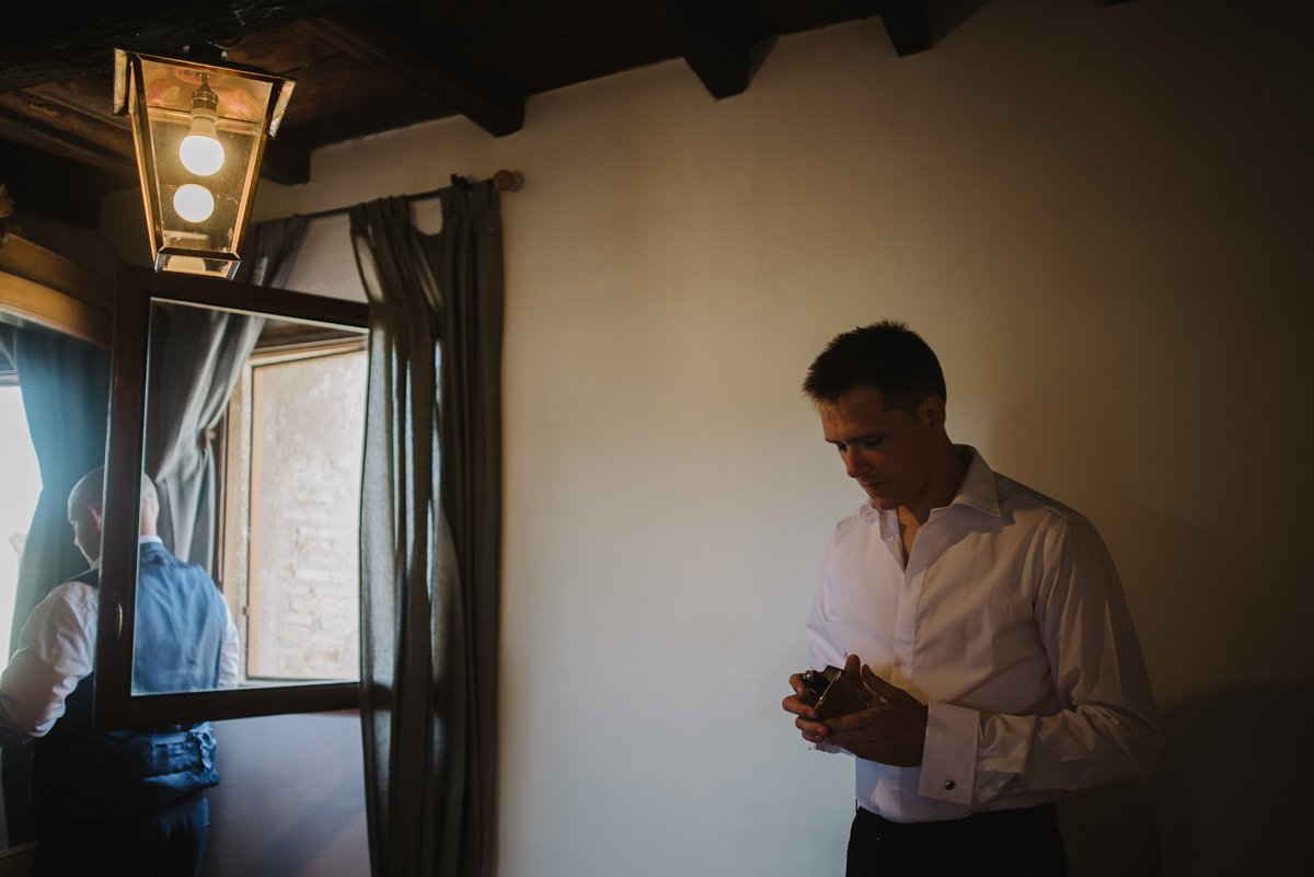 Destination Wedding photographer in Rome, Italy. Groom is getting ready
