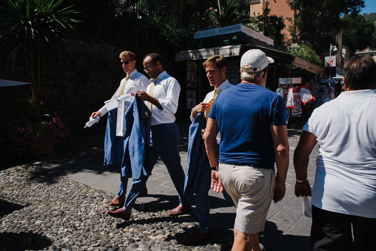 Destination wedding in Portofino, Cinque Terre. Groom walking in village