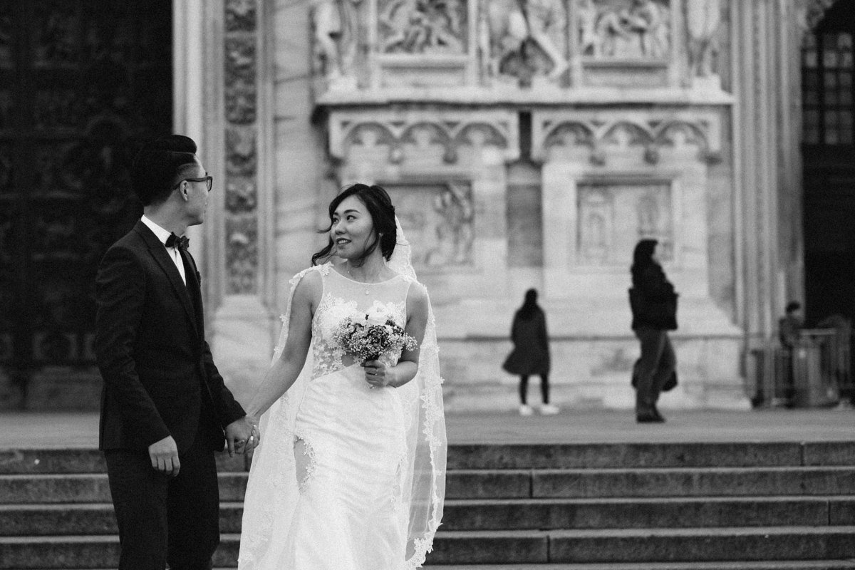 Destination wedding photographer in Milan. Bride and groom in front The Duomo