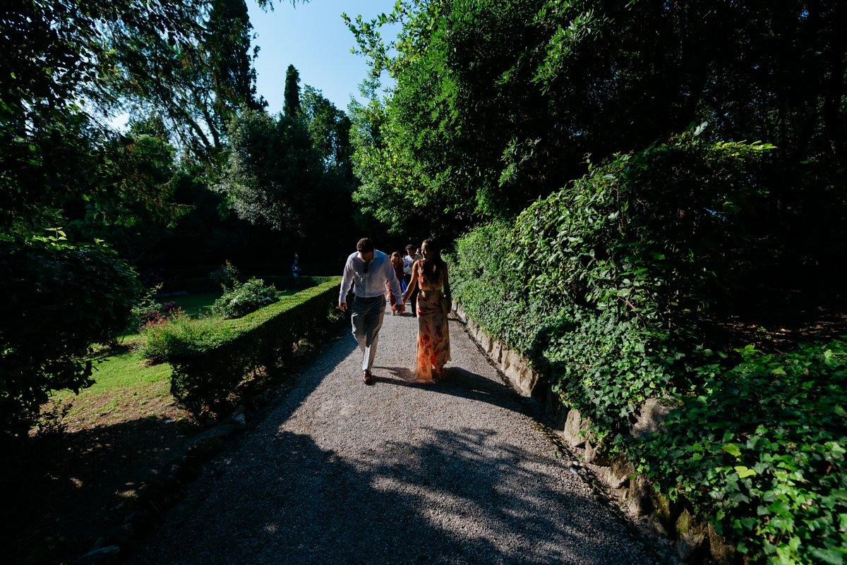 Destination wedding photographer in Lake Garda. Bride and groom in private villa garden