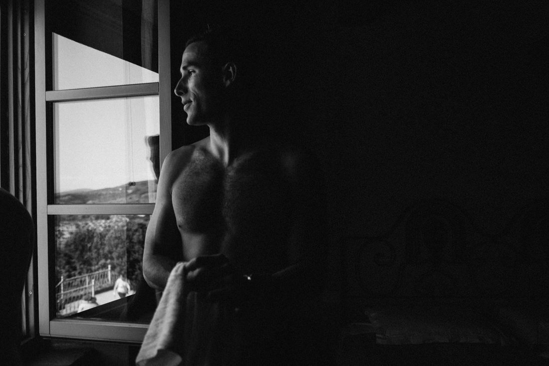 groom's getting ready in a Tuscan villa