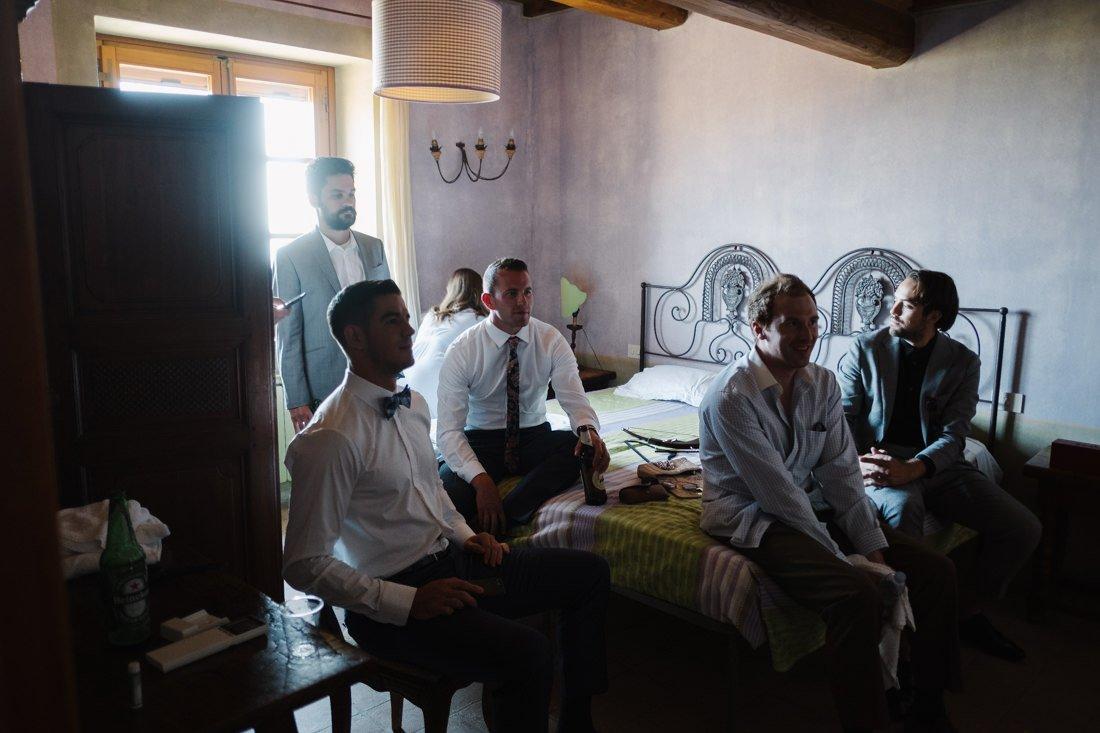 waiting for the bride , groomsmen portrait