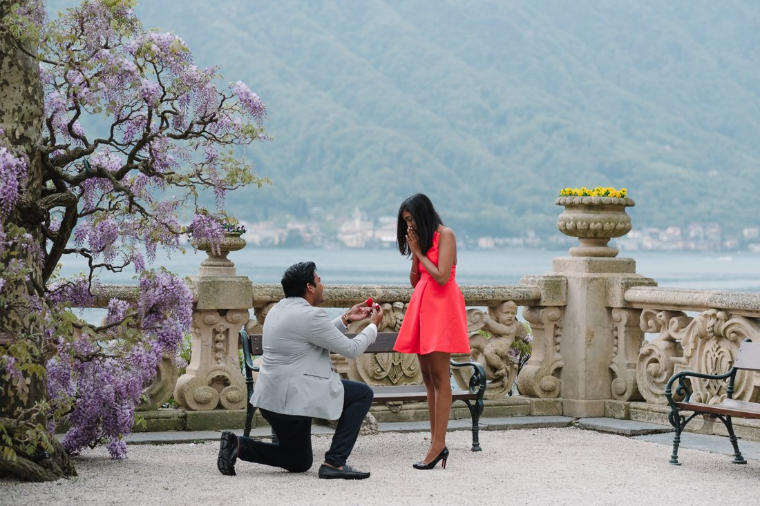 Indian wedding proposal photographer in Villa Balbianello, Lake Como. Groom to be holds out the ring