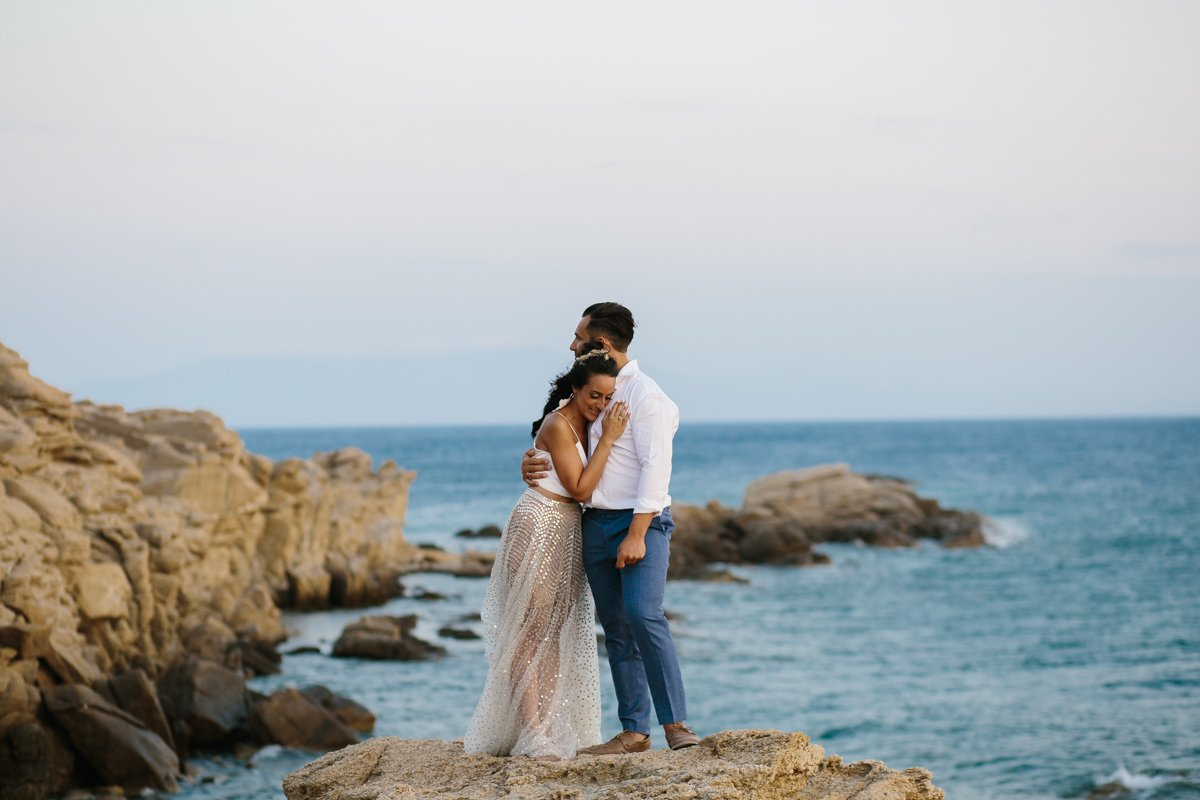 Destination Wedding Videographer & photographer in Mykonos. The couple embraced by the sea