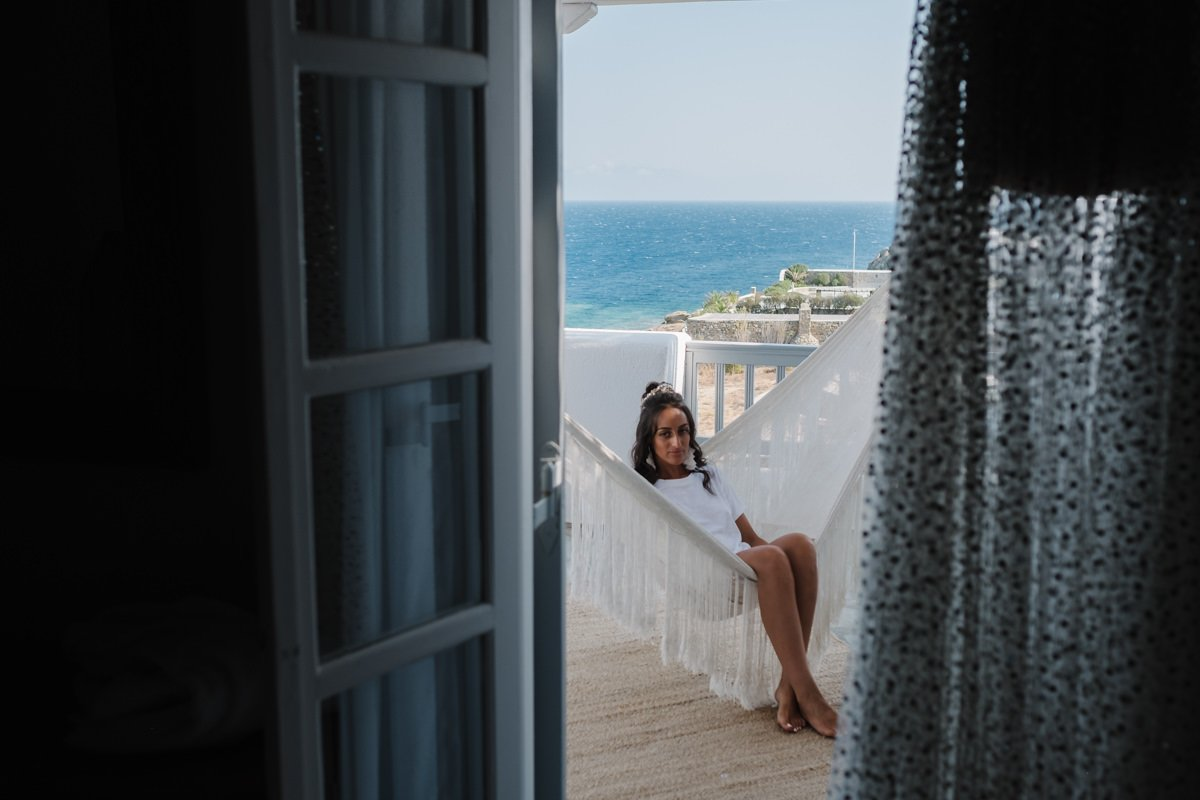 Wedding in greek islands. Bride in wedding venue, overlooking the mediterranean sea