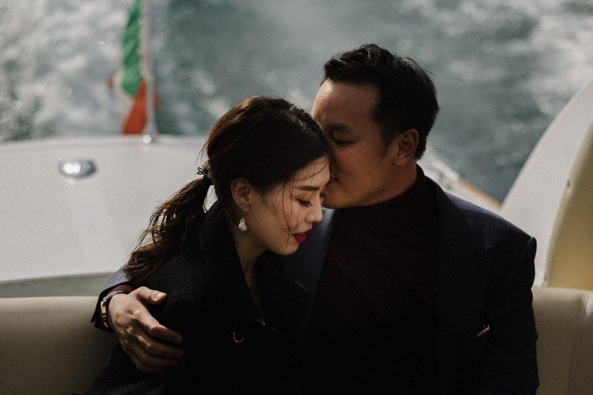Marriage proposal on lake como. Couple kiss