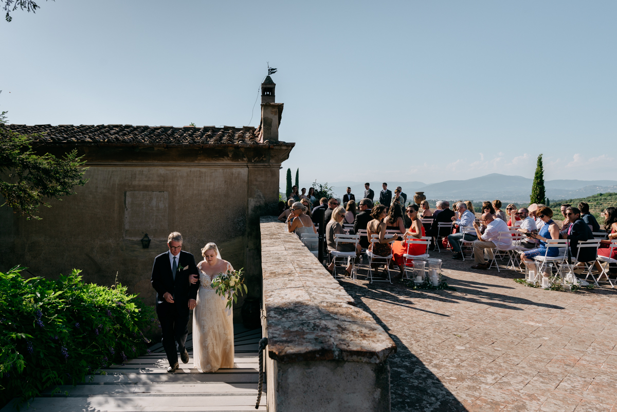 walking down the aisle at the tuscan villa