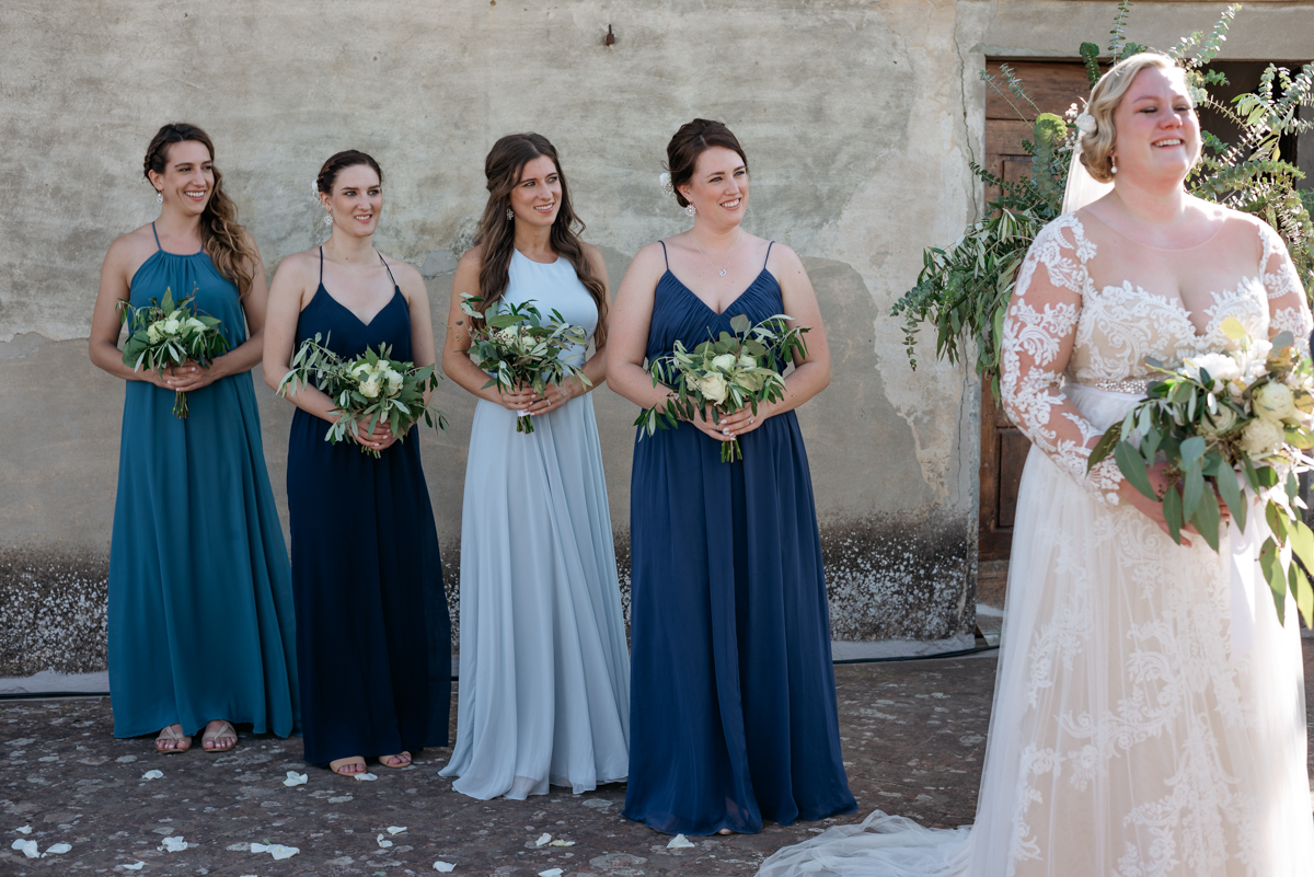 the bride and her bridesmaids with blue dresses