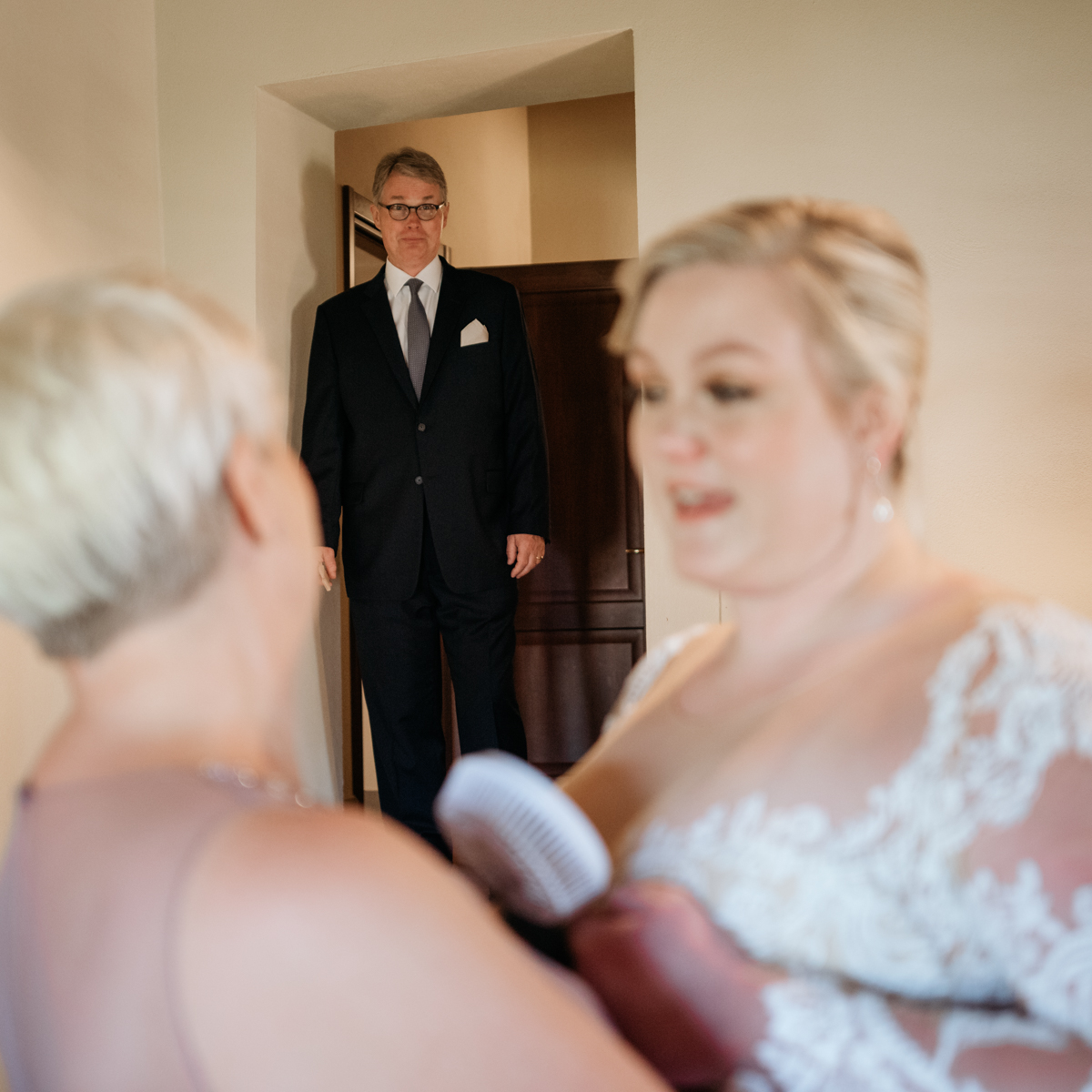 father of the bride looking at her for the first time