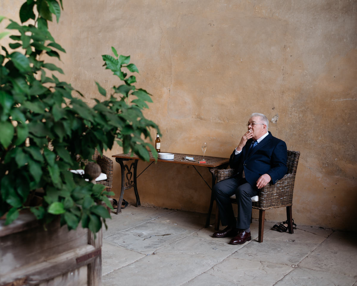 father of the groom relaxing at the castle in tuscany