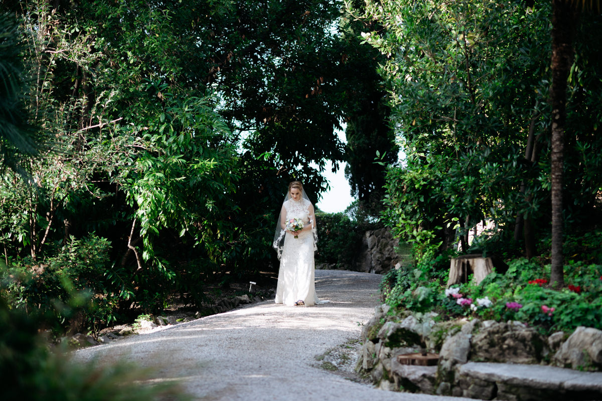the bride walks through the path to get to her groom